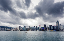 Yacht Hong Kong city buildings Royalty Free Stock Photos