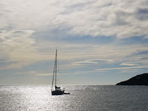 Yacht on the horizon Royalty Free Stock Images