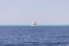 Yacht on the horizon Stock Image