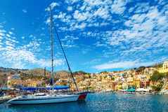 Yacht and houses on the symi island, Greece Royalty Free Stock Image