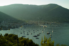 Yacht ih harbour of Komiza in the morning Stock Image
