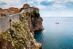 Yacht and Impregnable Walls of Dubrovnik Royalty Free Stock Image