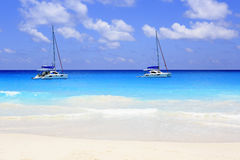 Yacht in the Indian Ocean on beach Anse Georgette Stock Image