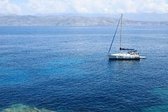 A yacht in Ionian Sea near Kanoni Beach, Kassiopi Village, Corfu Island, Greece, Europe royalty free stock photos