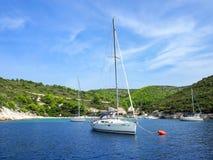 Yacht in an island bay with beach Stock Photos