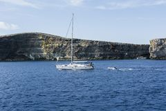 Yacht at the island Comino. Comino is a small island of the Maltese archipelago between the islands of Malta and Gozo in the Mediterranean Sea. Yacht at the Stock Photography