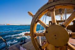 Yacht journey, steering wheel royalty free stock photos