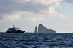 Yacht and Kicker Rock in the Galapagos Islands Stock Image