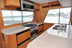 Yacht kitchen. Motor yacht kitchen inside cabin Stock Images