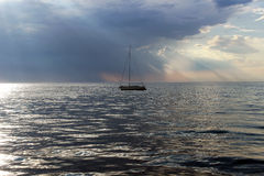 Yacht on the sea, evening sunlight. Lonely Yacht in the Koper port, Slovenia Royalty Free Stock Photography