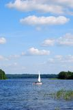 Yacht on the lake. White yacht on the lake surface, Plateliai, Lithuania, travel Europe Stock Images