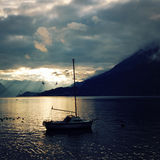 Yacht on Lake Como at the sunset. Pleasure boat. Royalty Free Stock Photography