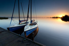 Yacht on lake harbor at sunrise Stock Photo