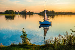 Yacht in lake. Small yacht at sunset time, Trakai lake Galve stock photography