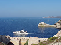 Yacht leaving Bonifacio harbor, Corsica, France Stock Images