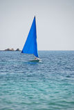 Yacht in light blue aegean sea. Yacht sailing in the aegean sea, nearby the coastline of Skiathos Stock Image