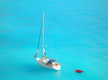 Yacht in light blue ionian sea. Yacht full of tourists sailing in the Ionian sea, nearby the coast of the Greek island Lefkada Stock Photography
