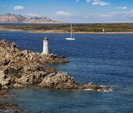 Yacht and lighthouse Royalty Free Stock Image