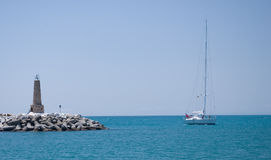 Yacht and lighthouse. Spain. Stock Images