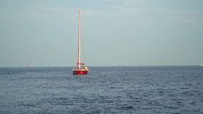 The yacht with the lowered sails on the high seas. stock footage