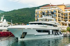Yacht at Luxury Waterfront Mansion in Porto Montenegro Stock Image
