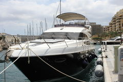 Yacht in the Maltese harbour Stock Photos