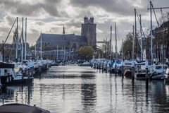 Yacht marina in Dordrecht, Netherlands, with in the background the Grote Kerk. Under a very cloudy sky Royalty Free Stock Photography