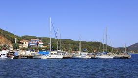 Yacht marina in the fishing village of Porto Koufo. Stock Photos