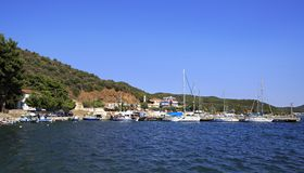 Yacht marina in fishing village of Porto Koufo. Stock Photo