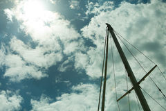 Yacht mast against blue summer sky. Yachting royalty free stock photography