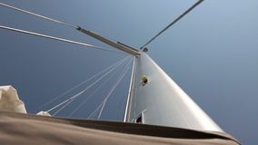 Yacht mast close-up. Day with blue sky stock video footage