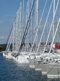 Yacht masts in marina. Sailing yachts out of season in marina Royalty Free Stock Image