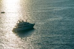 Yacht in the Mediterranean Sea at sunset, luxury travel tour, space for text, summer, ocean surface, water transport, fishing, stock photo