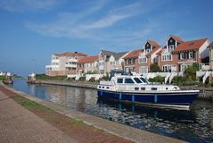 Yacht modern houses waterfront Stock Images