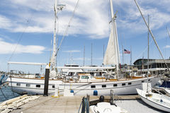 Yacht moored at dock Stock Photos