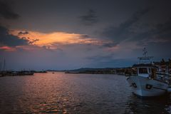 Yacht moored at dock, sunset view in Grecce stock images