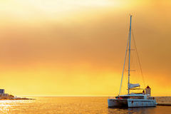 Yacht moored in the harbor of a small town called Postira - Croatia, island Brac Stock Photography