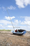 Yacht moored at low tide. Royalty Free Stock Images