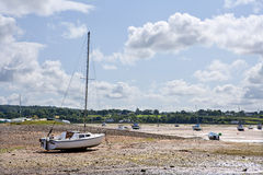Yacht moored at low tide. Yacht moored at low tide, Anglesey, Wales stock photography