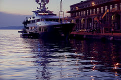 Yacht moored at Maritime Station in Trieste, Italy at sunset Stock Image
