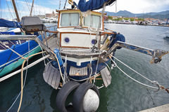 Yacht moored on the platform in Saint-Florent`s port Royalty Free Stock Photography