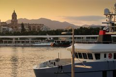 Malaga Cathedral at sunset. Yacht moored in the port of Malaga with Cathedral in the background at sunset Royalty Free Stock Image