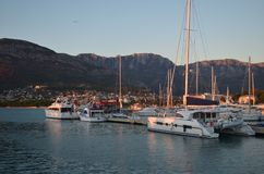 Yacht moored in sunset`s marina. Royalty Free Stock Image