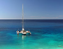 Yacht moored in tropical waters Royalty Free Stock Photo
