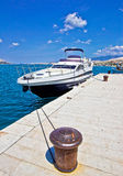 Yacht on mooring bollard dock Royalty Free Stock Photography