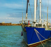 Yacht mooring in harbor Stock Images