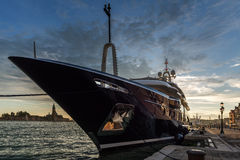 The yacht at the mooring in Venice royalty free stock photo