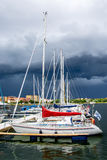 Yacht or motor boat at harbor Stock Images