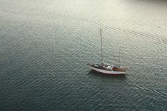 Yacht in move. White yacht on move in sea royalty free stock photos