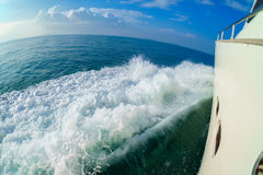 Yacht moving in calm sea and making a wave. Yacht moving in calm sea near Phuket stock photography